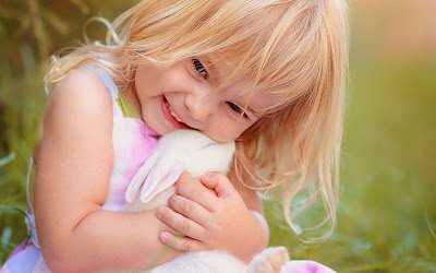 cute-girl-playing-with-rabbit.jpg